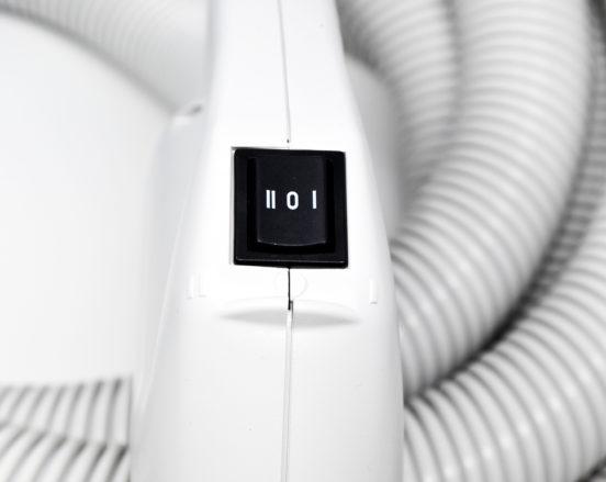 Flexible central vacuum hose power switch