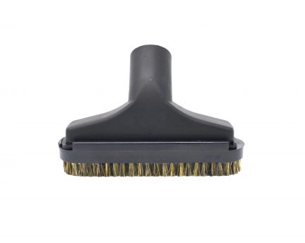 Upholstery tool features a directional slide brush which assures a consistent fit and detaches for aggressive clea